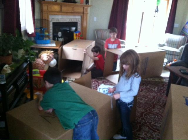 Building hurricane shelters out of old moving boxes.